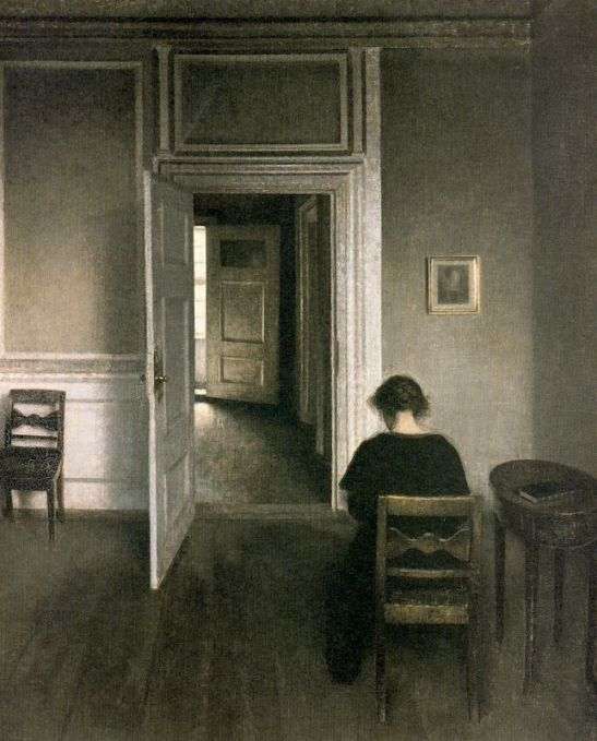 interior-with-woman-dressed-in-black-sitting-on-yellow-brown-chair-strandgade-1908